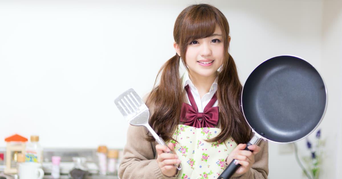 料理をする美少女