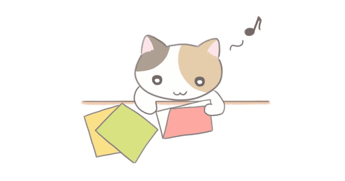 折り紙をする猫